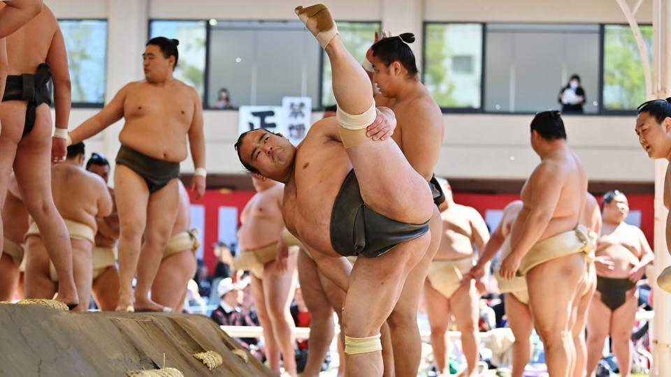 "Sumo wrestlers take part in a ""honozumo,"" a ceremonial sumo exhibition, on the grounds of Yasukuni Shrine in Tokyo, Japan. (Charly Triballeau / AFP)"