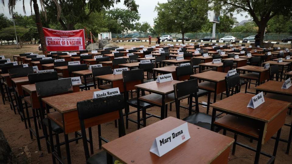 Names of the remaining Chibok schoolgirls are displayed with their desk during the 5th Year Commemoration of the abduction of the 276 Chibok Schoolgirls by Boko Haram on April 14, 2014 from Government Secondary School, Chibok, Borno State, Nigeria. (Kola Sulaimon / AFP)