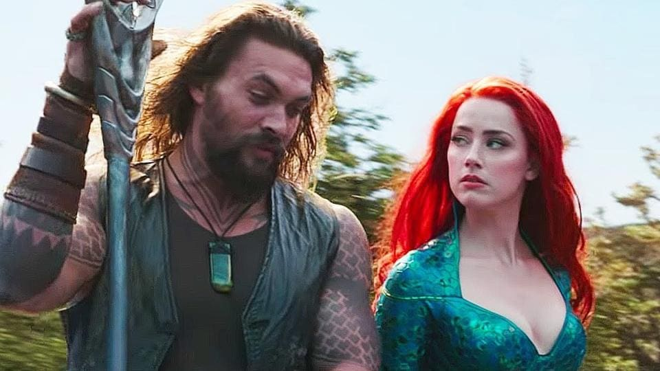Amber Heard and Jason Momoa in a still from Aquaman.