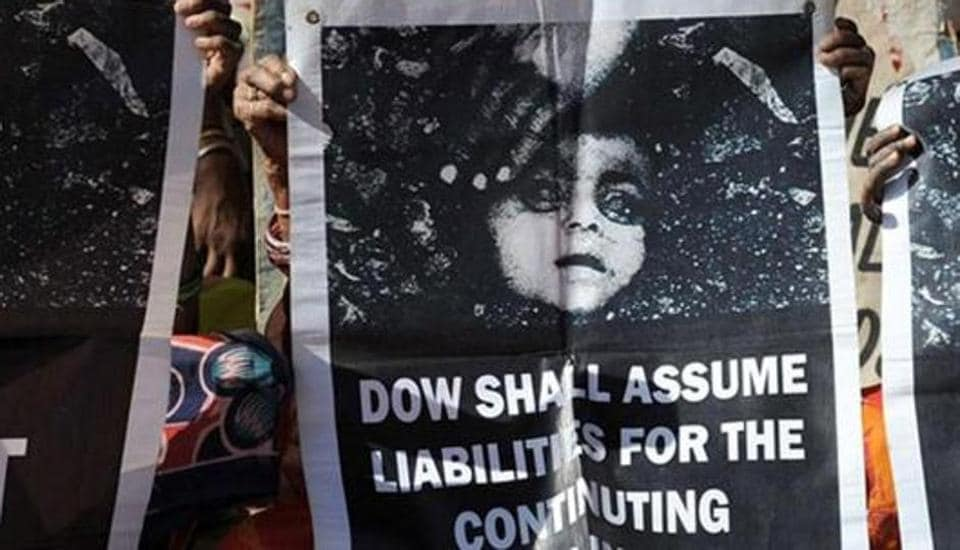 Bhopal gas disaster survivors hold posters during a protest rally in Bhopal. (AFP File Photo)