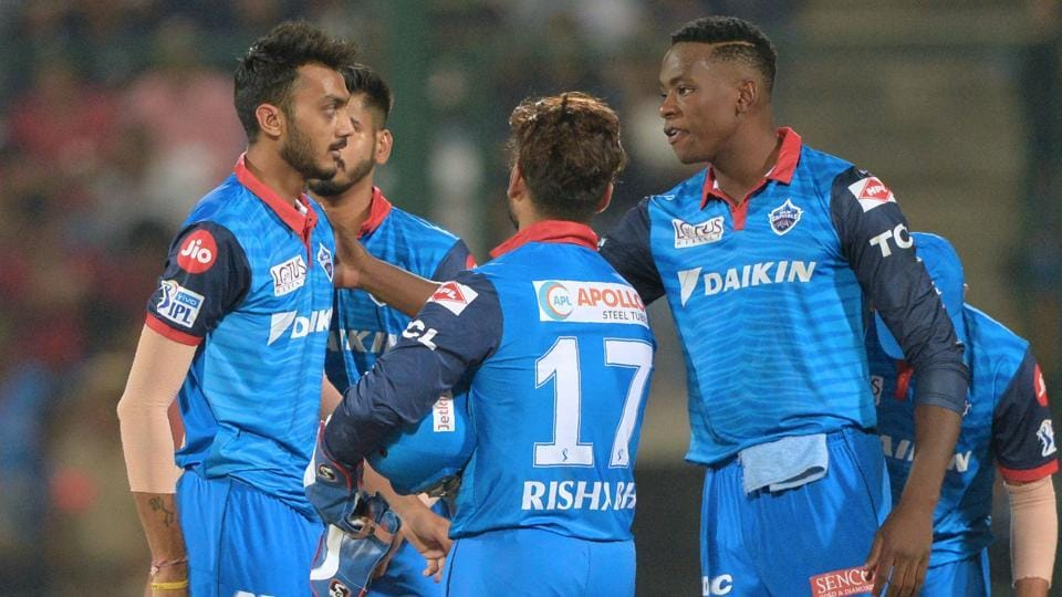 Delhi Capitals team players celebrate after the fall of a wicket.