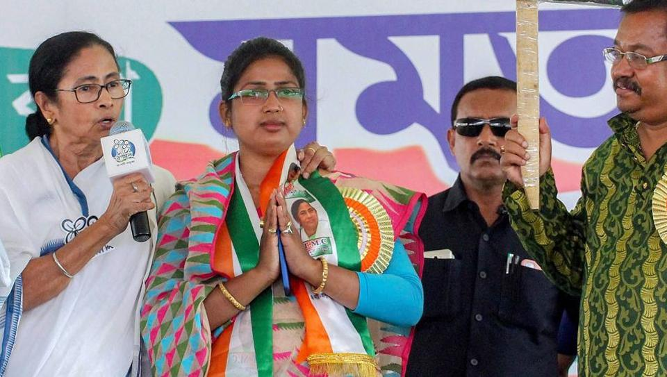 West Bengal Chief Minister and Trinamool Congress supremo Mamata Banerjee addresses an election campaign rally for her party candidate from Ranaghat Parliamentary constituency Rupali Biswas (C) for the Lok Sabha polls, in Nadia, Saturday.