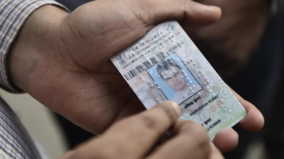 Aniruddha Kumar, a 32-year-old professor in PGDAV College got his braille-coded voter card which was distributed by the Chief Election Commissioner at Kashmere Gate in Delhi. These braille-coded voter cards were distributed to visually impaired electors of East Delhi, in consonance with the Election Commission's aim to make the polls more accessible to the disabled. (Sanchit Khanna / HT Photo)