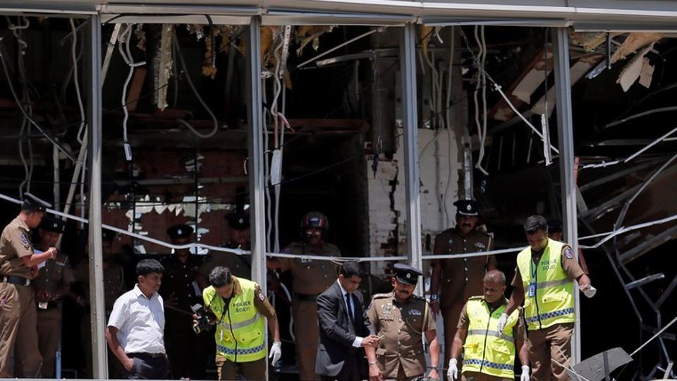 Crime scene officials inspect the explosion area at Shangri-La hotel in Colombo