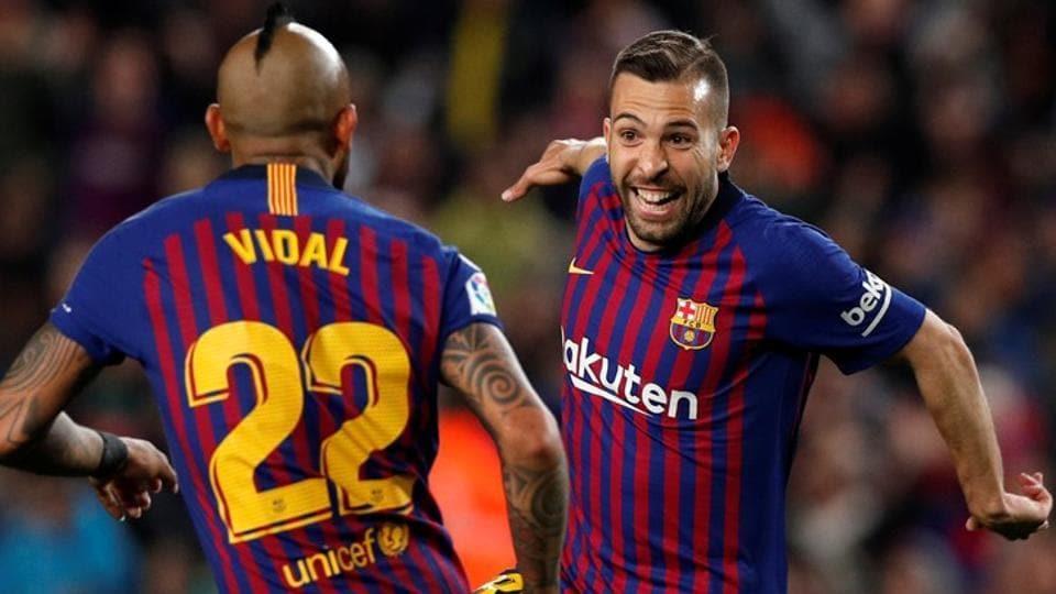 Barcelona's Jordi Alba celebrates scoring their second goal with Arturo Vidal.