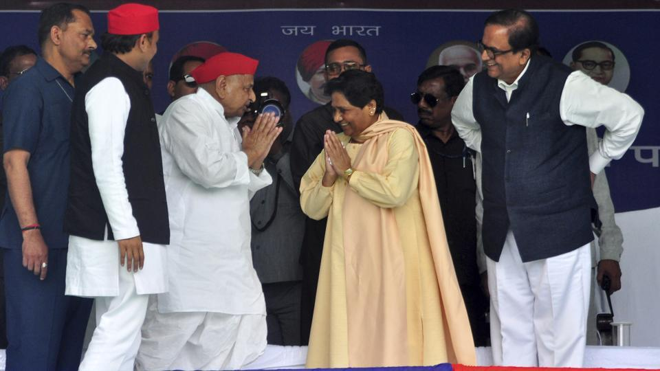 Samajwadi Party (SP) leader Mulayam Singh Yadav, center left, and Bahujan Samaj Party chief Mayawati, center right, greet each other watched by SP President Akhilesh Yadav, second left, at a joint election rally in Mainpuri