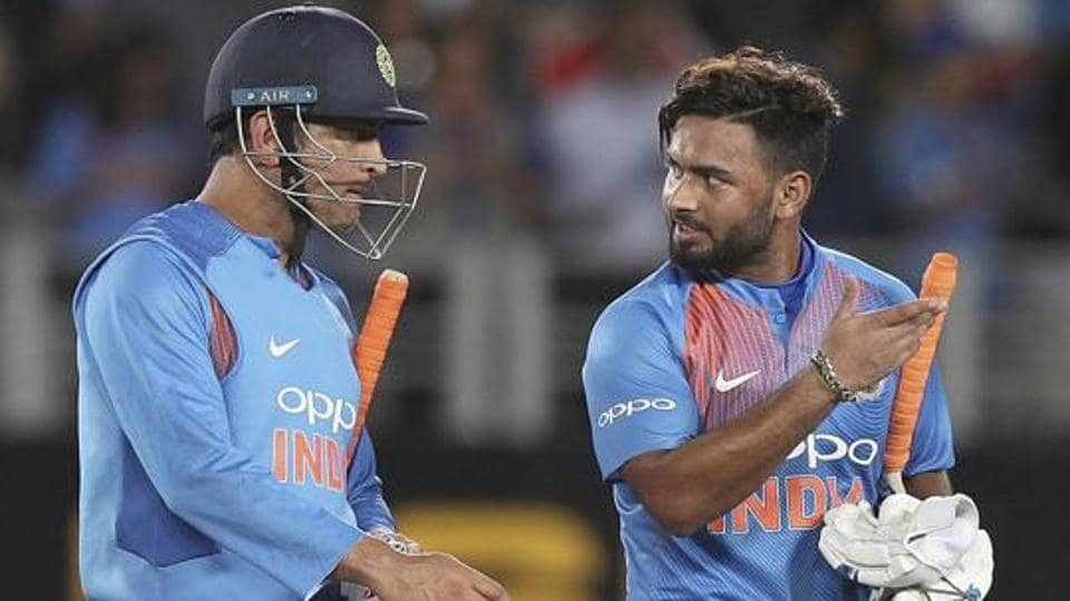India's MS Dhoni, left, and Rishabh Pant talk after the end of  a match.