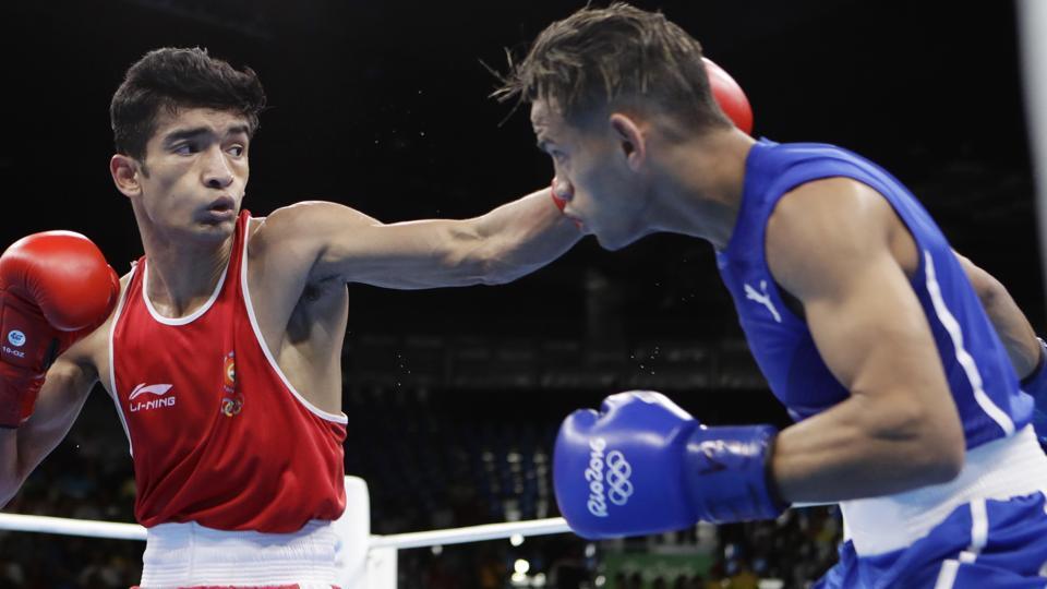 India's Shiva Thapa, left, fights Cuba's Robeisy Ramirez during a men's bantamweight 56-kg preliminary boxing match.