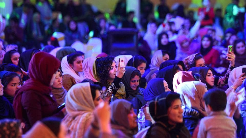 Afghan women watch a performance by Afghan singer Seeta Qasemi during a concert in Mazar-i-Sharif. A second summit between Afghan delegates and the insurgents that was to take place in Doha this weekend and had been set to include more women has been postponed indefinitely. International observers have blasted the talks, led on the US side by peace envoy Zalmay Khalilzad, for their lack of female inclusion. (Farshad Usyan / AFP)
