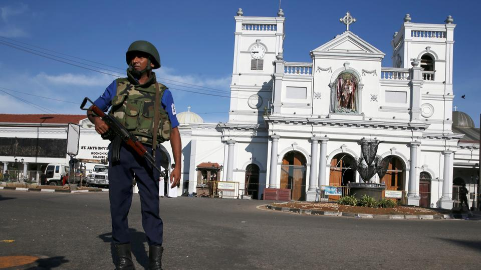 A security officer stands in front of St Anthony's shrine in Colombo, after bomb blasts ripped through churches and luxury hotels on Easter, in Sri Lanka April 22, 2019.