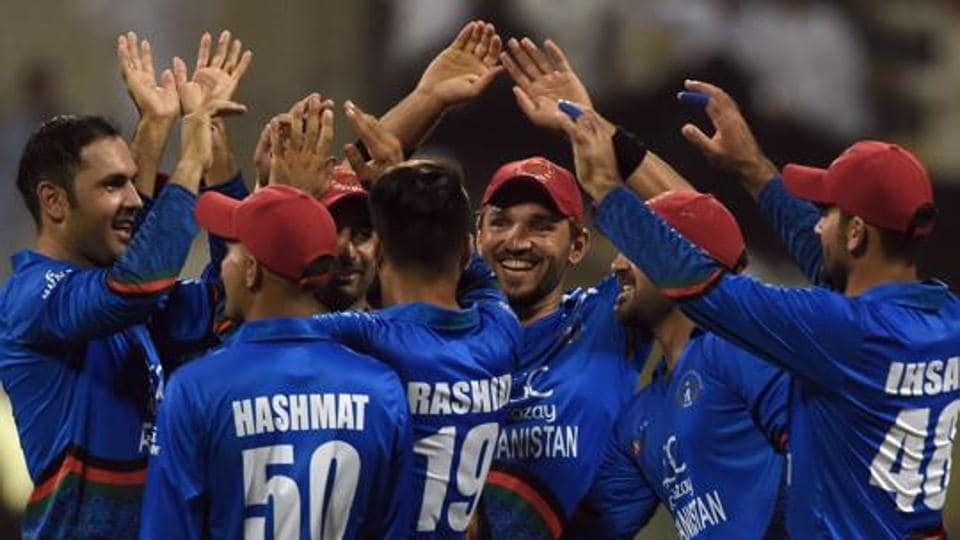 Afghan cricketer Mohammad Nabi (L) celebrates with teammates after he dismissed Sri Lanka's cricket team captain Angelo Mathews during the one day international (ODI) Asia Cup cricket match between Sri Lanka and Afghanistan at the Sheikh Zayed Stadium in Abu Dhabi on September 17, 2018.