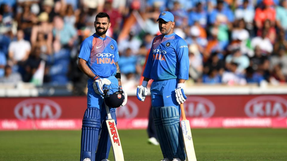 CARDIFF, WALES - JULY 06: MS Dhoni and Virat Kohli of India during the 2nd Vitality International T20 match between England and India at SWALEC Stadium on July 6, 2018 in Cardiff, Wales. (Photo by Gareth Copley/Getty Images)