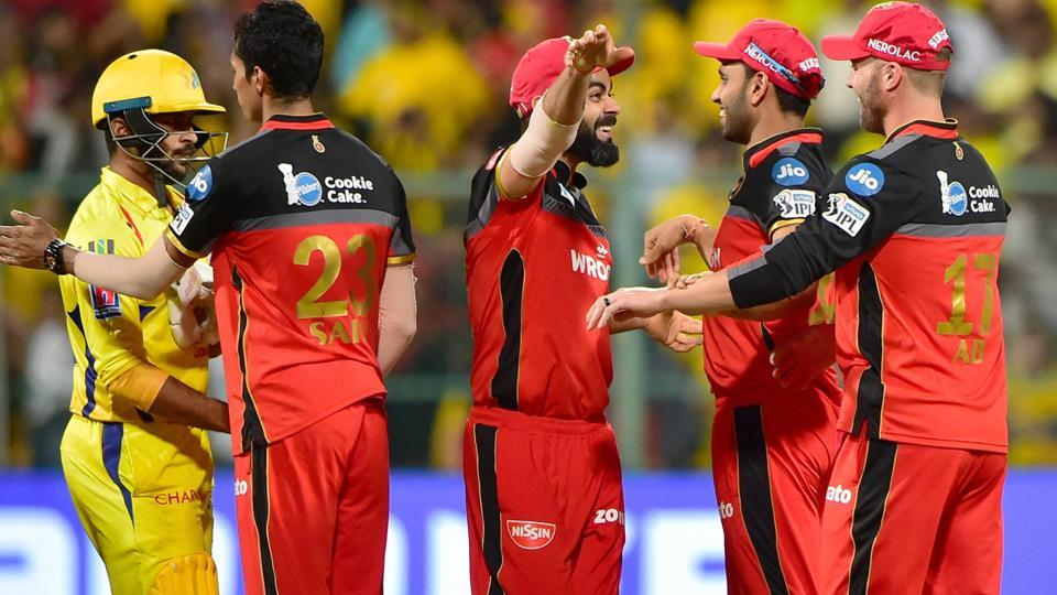RCB Skipper Virat Kohli with team mates celebrate after his team won the match by 1 run. (PTI)