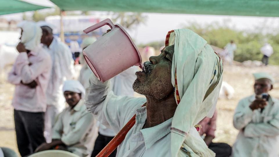 "A man drinks water at a cattle market in Beed. ""There are two narratives tugging at voters, not only in Maharashtra but all of India,"" said Sudha Pai, a political science professor at New Delhi's Jawaharlal Nehru University. ""One is that of lack of jobs and the agrarian crisis. And the other is the sentimental pull of identity and national security."" (Dhiraj Singh / Bloomberg)"