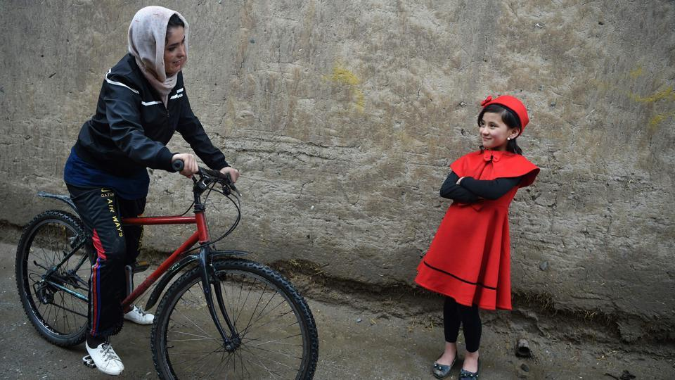 "Kobra Samim, who rides for Afghanistan's national cycling team, wrote on Facebook that women's participation in sport is her ""red line"" as the US tries to forge a peace deal with the Taliban. ""If the Taliban come back, we won't have the right to education, sports, and we will even be banned from coming out of houses,"" Samim, 23, told AFP before setting off along a run-down Kabul street. (Wakil Kohsar / AFP)"