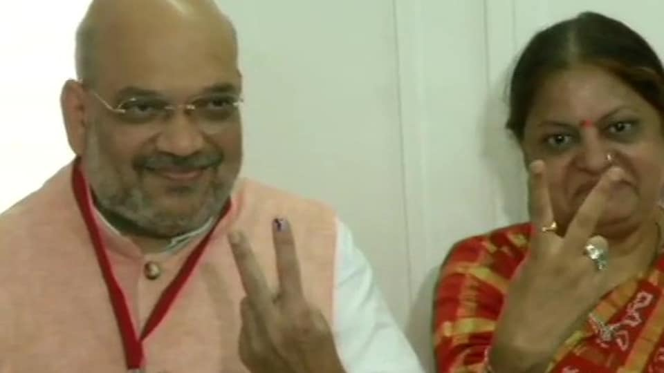BJP President Amit Shah and his wife Sonal Shah cast their votes at polling booth in Naranpura Sub-Zonal office in Ahmedabad