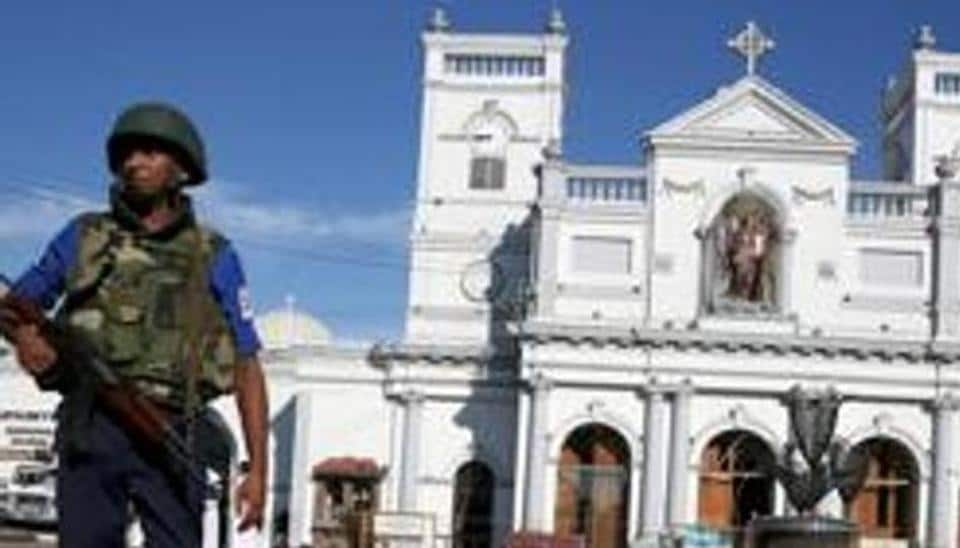 A security officer stands in front of St Anthony's shrine in Colombo, after bomb blasts ripped through churches and luxury hotels on Easter, in Sri Lanka on Monday.