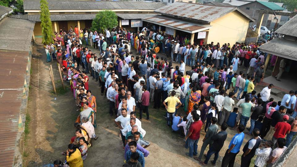Voters stand in lines at a polling station in Guwahati, Assam. Voting is taking place for all 26 constituencies in Gujarat, all 20 seats in Kerala, 14 each in Maharashtra and Karnataka, 10 in Uttar Pradesh, seven in Chhattisgarh, six in Odisha, five each in Bihar and West Bengal, four in Assam, two in Goa, one each in Jammu and Kashmir, Dadra and Nagar Haveli, Daman and Diu and Tripura. (Biju Boro / AFP)