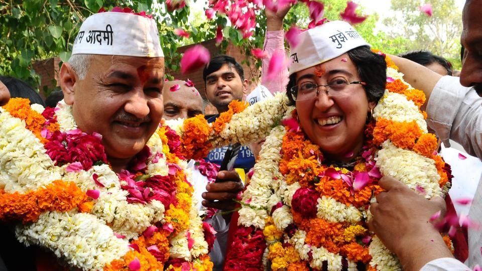 Aam Aadmi Party (AAP) candidate from East Delhi, Atishi with Delhi Deputy Chief Minister Manish Sisodia shows victory sign on her way to file nomination form for the upcoming Lok Sabha elections 2019 in New Delhi on Monday.