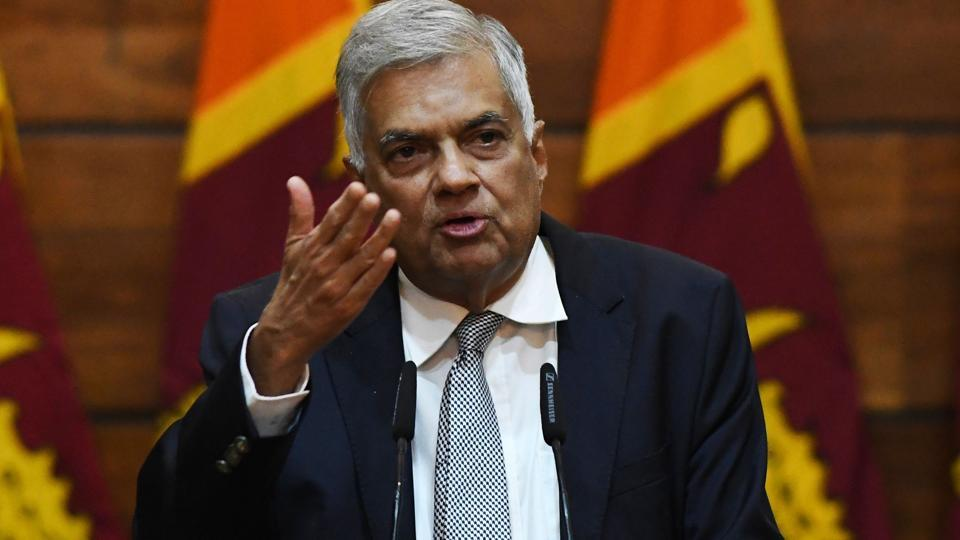 Prime Minister of Sri Lanka Ranil Wickremesinghe gestures as he answers questions from a journalist during a press conference in Colombo on April 23, 2019.