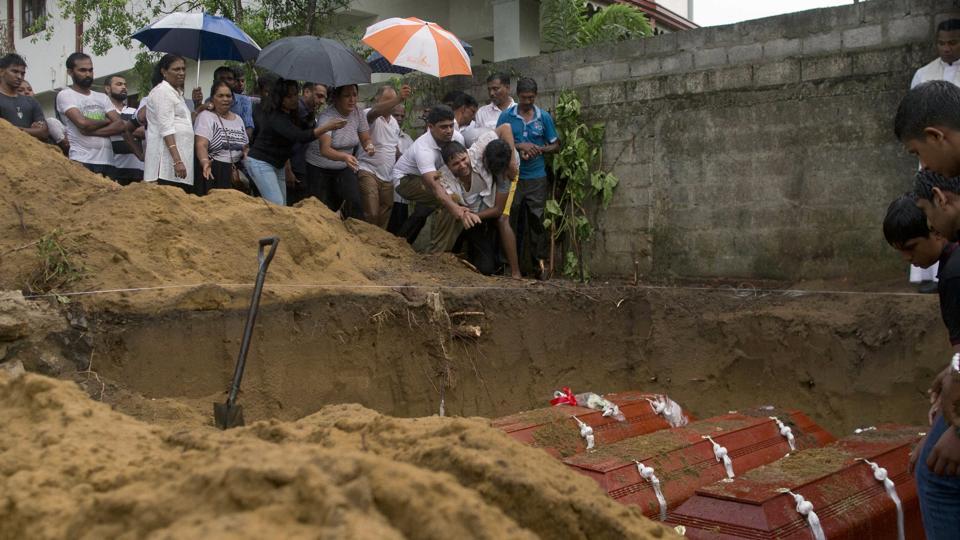 Relatives bury three members of the same family, all died at Easter Sunday bomb blast at St. Sebastian Church in Negombo, Sri Lanka, Monday