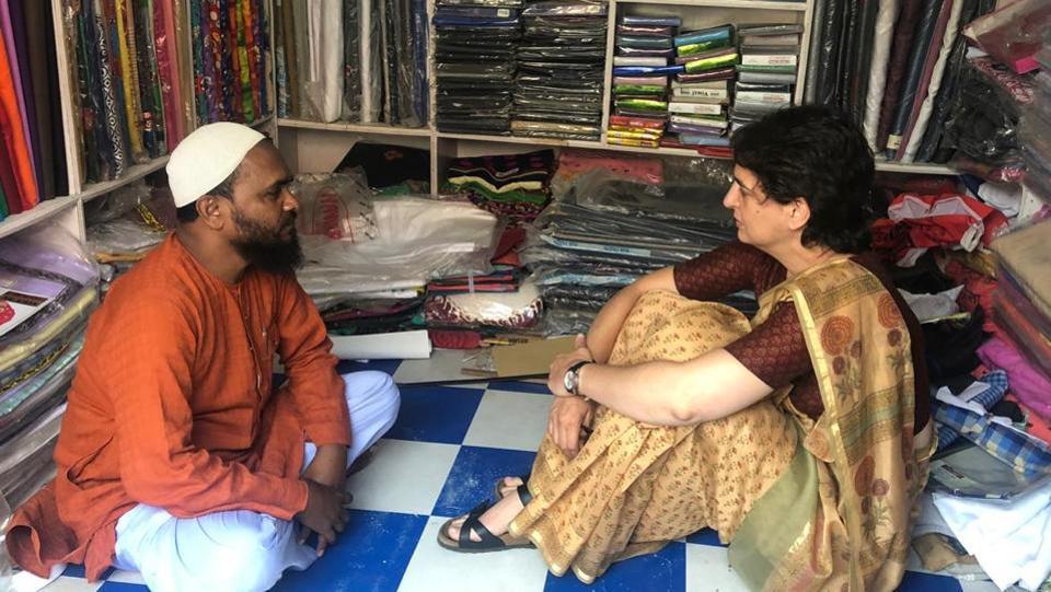 Congress general secretary Priyanka Gandhi Vadra talks to a shopkeeper in Amethi on Tuesday