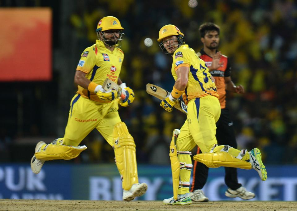 Chennai Super Kings cricketer Shane Watson (R) Suresh Raina (L) run between wickets during the 2019 Indian Premier League (IPL) Twenty20 cricket match between Chennai Super Kings and Sunrisers Hyderabad at the M.A. Chidhambaram Stadium in Chennai. (AFP)