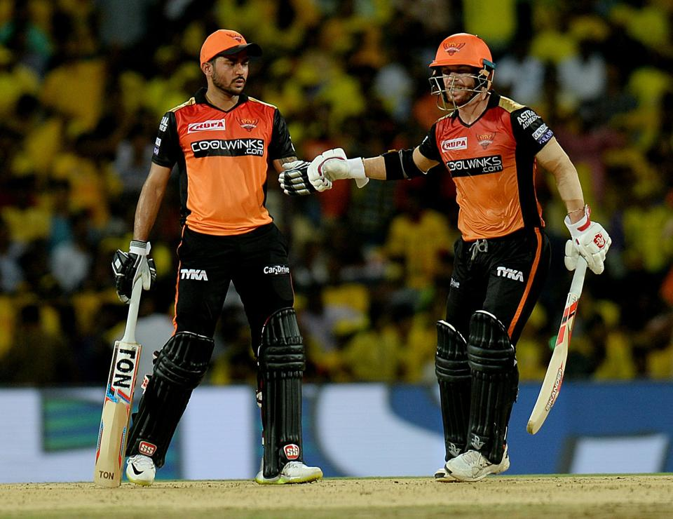 Sunrisers Hyderabad cricketers David Warner (R) and Manish Pandey (L) touch gloves during the 2019 Indian Premier League (IPL) Twenty20 cricket match between Chennai Super Kings and Sunrisers Hyderabad at the M.A. Chidhambaram Stadium in Chennai. (AFP)