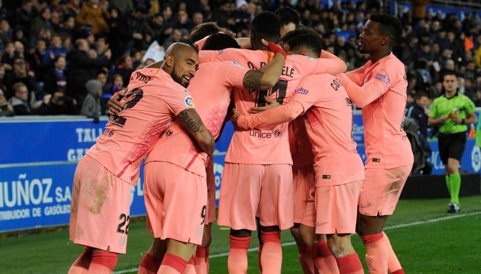Barcelona's players celebrate their second goal during the Spanish league football match between Deportivo Alaves and FC Barcelona at the Mendizorroza stadium in Vitoria on April 23, 2019