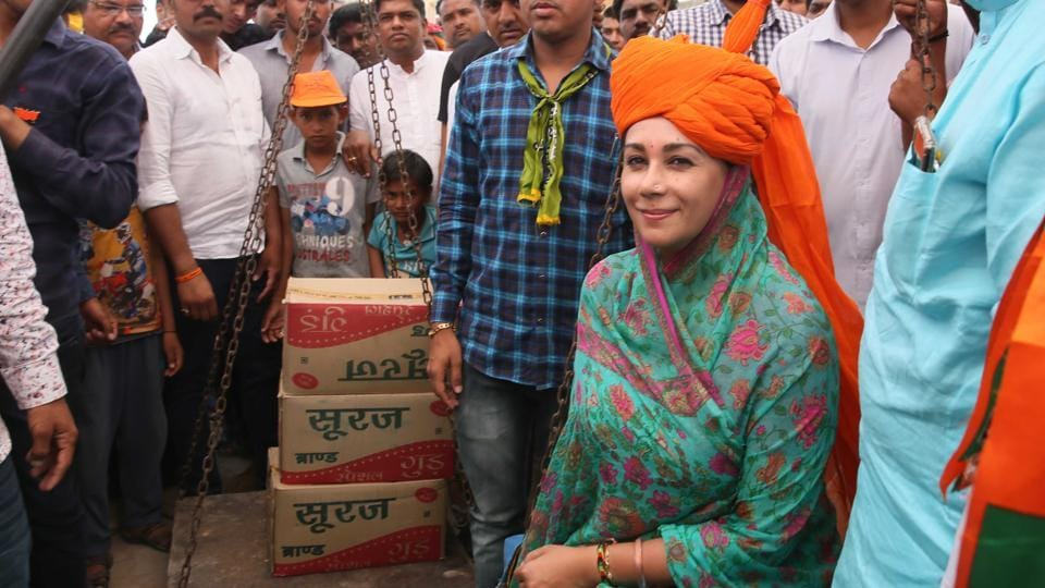 BJP candidate Diya Kumari being weighed with jaggery during her campaign in the Rajsamand Lok Sabha seat.