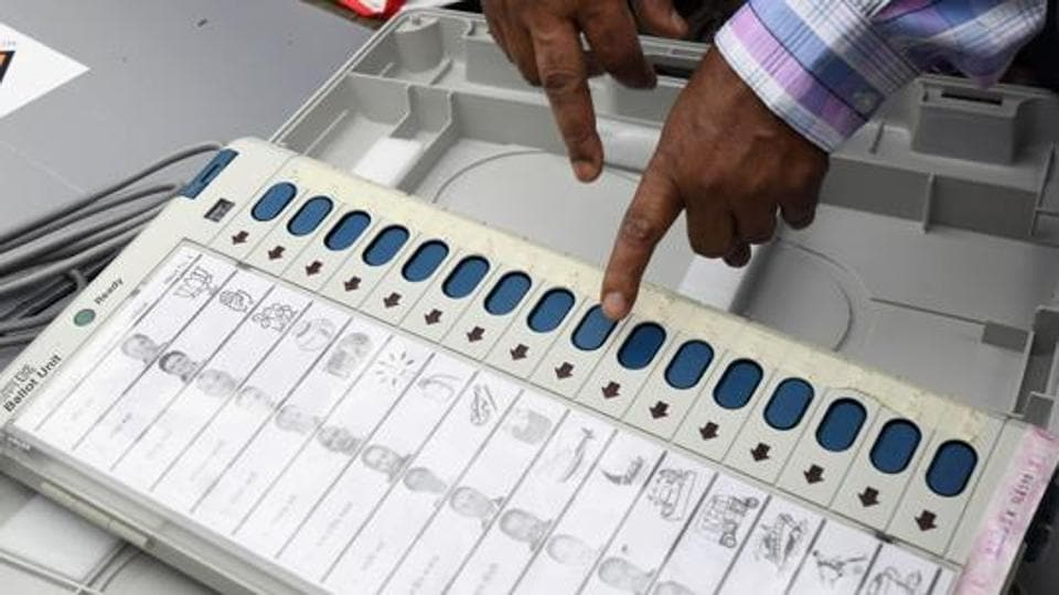 An Indian election official examines an Electronic Voting Machine (EVM) at a distribution centre ahead of the third phase of India's general election at Amigaon in Kamrup district in the northeastern state of Assam on April 22, 2019. (Photo by Biju BORO / AFP)
