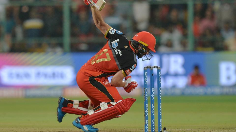 Royal Challengers Bangalore batsman AB De Villiers trips after playing a shot. (AFP)