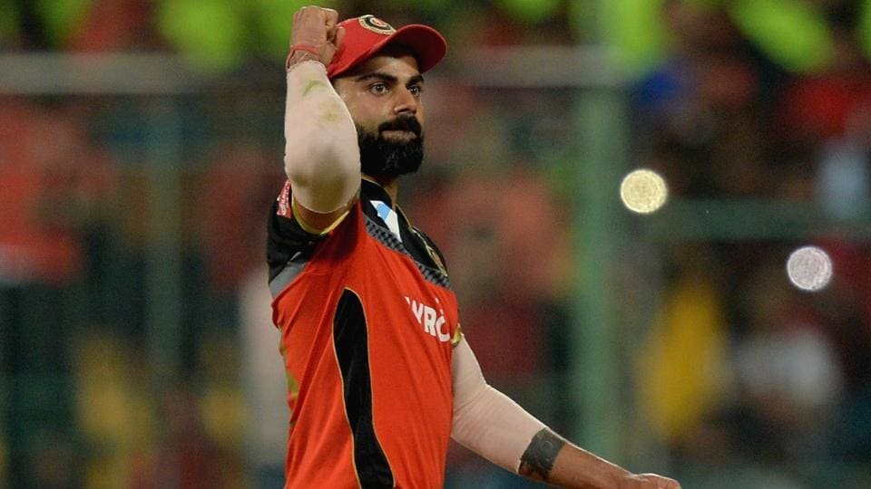 Royal Challengers Bangalore captain Virat Kohli pumps his fist as he celebrates the team's 17 run victory. (AFP)