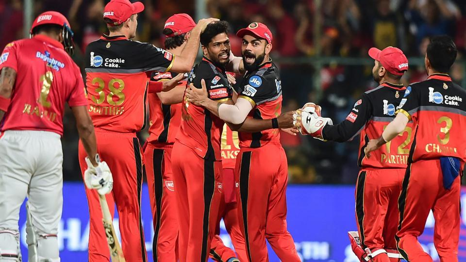 RCB Skipper Virat Kohli and bowler Umesh Yadav celebrate with teammates after dismissal of KXIP batsman Chris Gayle. (PTI)