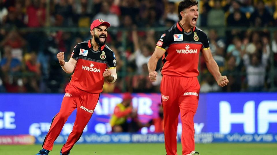 RCB bowler Marcus Stoinis and captain Virat Kohli celebrate after the dismissal of KXIP batsman Mayank Agarwal. (PTI)