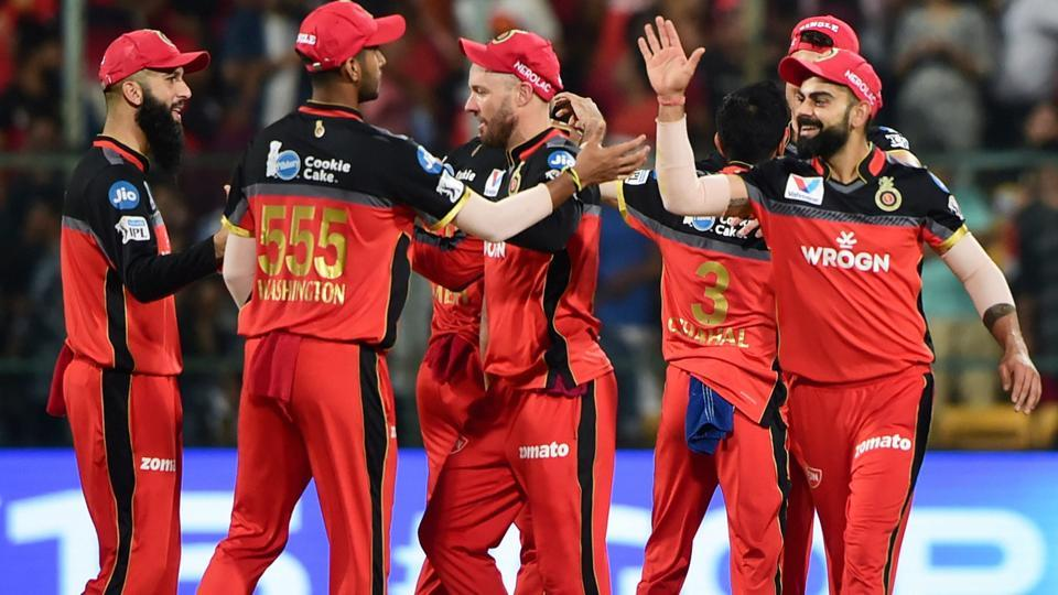 Bengaluru: RCB Skipper Virat Kohli celebrate with teammates after victory over KXIP. (PTI)