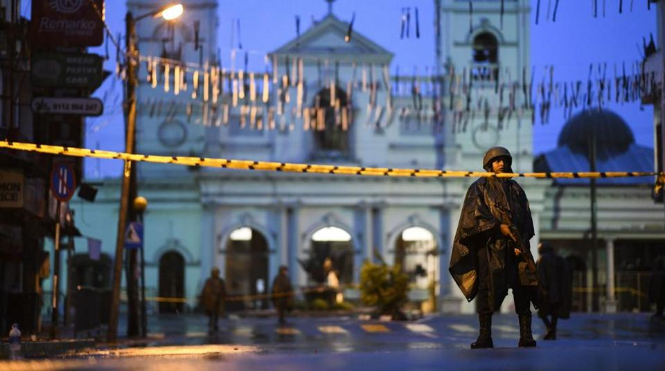 Sri Lankan soldiers stand guard under the rain at St. Anthony's Shrine in Colombo on April 25, 2019, following a series of bomb blasts targeting churches and luxury hotels on the Easter Sunday in Sri Lanka.