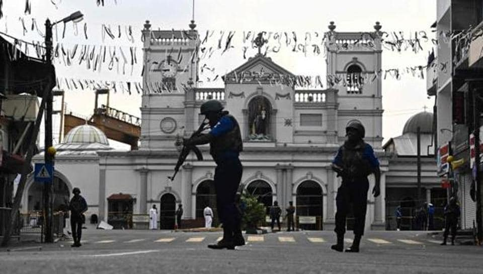 Security personnel stand guard in front of St. Anthony's Shrine in Colombo on April 23, 2019, two days after a series of bomb blasts targeting churches and luxury hotels in Sri Lanka