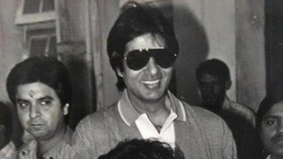 A young Amitabh Bachchan poses with his son Abhishek.