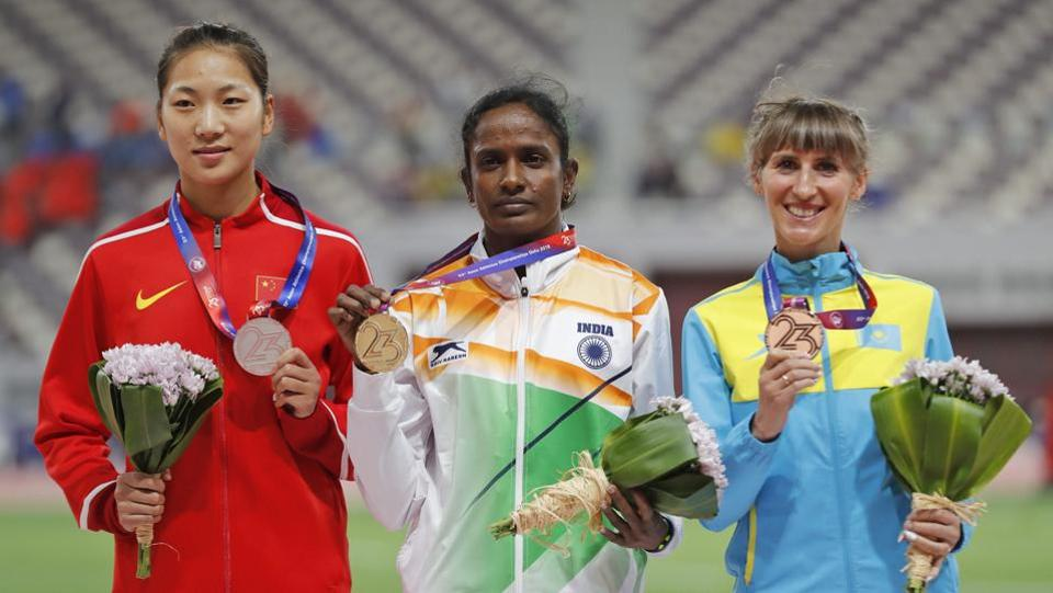 (L-R) China's Wang Chunyu, India's Gomathi Marimuthu, and Kazakhstan's Margarita Mukasheva display their silver, gold and bronze medals respectively for the women's 800-meters race at the Asian Athletics Championships in Doha, Qatar. (PTI / AP)