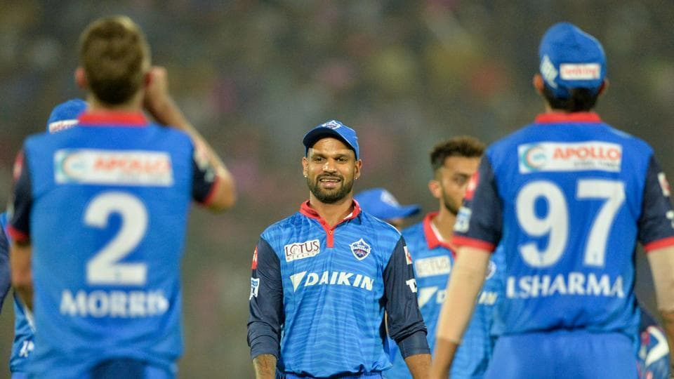 Delhi Capitals players celebrate after the fall of a wicket.