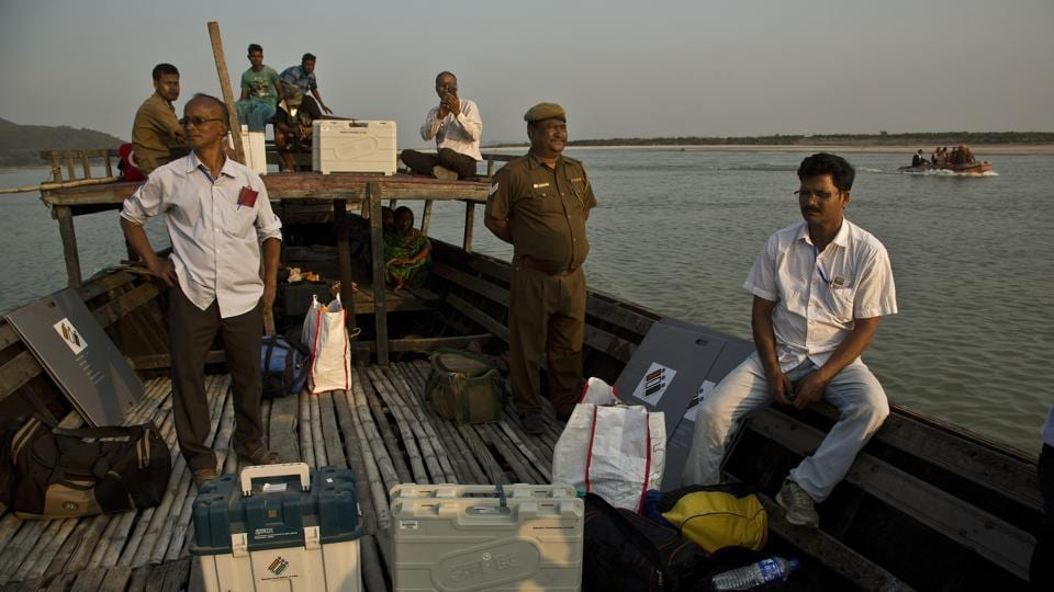 Indian election officials with polling materials travel on a country boat to reach a polling centre located in a remote river island, west of Guwahati, Assam. (Anupam Nath / AP)