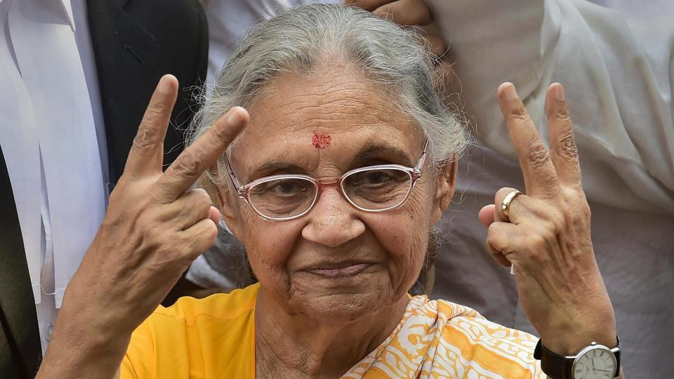 DPCC President Sheila Dikshit flashes the victory sign as she leaves after filing her nomination papers from North East Delhi parliamentary seat, in New Delhi. (Manvender Vashist / PTI)