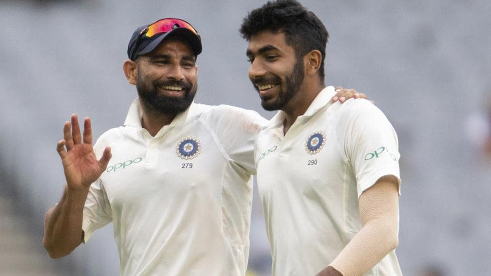 India's Mohammed Shami, left, speaks with Jasprit Bumrah during play.