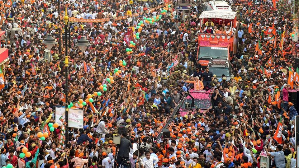 Prime Minister Narendra Modi waves at supporters during his roadshow, a day ahead of filing his nomination papers for the Lok Sabha polls, in Varanasi, Uttar Pradesh. (Manvender Vashist / PTI)