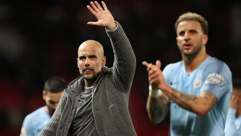 Manchester City manager Pep Guardiola and Manchester City's Kyle Walker after the match.