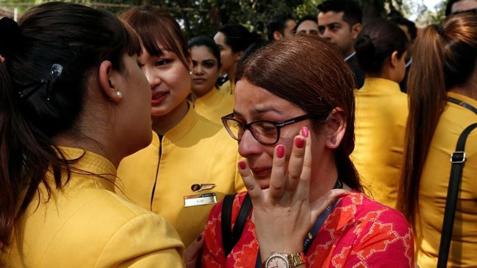 "An employee of Jet Airways is consoled by her colleagues during a protest demanding to ""save Jet Airways"" in New Delhi. (Adnan Abidi / REUTERS)"