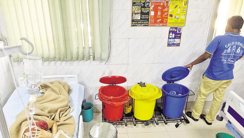 Bins for biomedical waste kept near a patient's bed in the emergency ward.