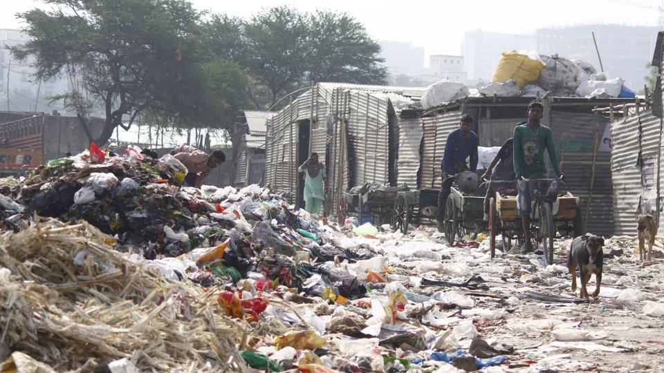 On a typical day in the slums of Nathupur, a village that borders Cyber City and DLF Phase 3, men can be seen sifting through the garbage that arrives in trucks.