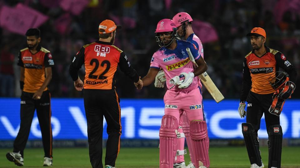 Rajasthan Royals batsman Sanju Samson (2nd R) shakes hand with Sunrisers Hyderabad captain Kane Williamson (2nd L) after Rajasthan Royals won the 2019 Indian Premier League